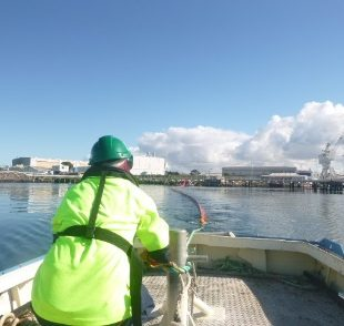 One of our vessels towing out oil pollution boom