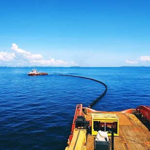 An offshore vessel performing oil spill